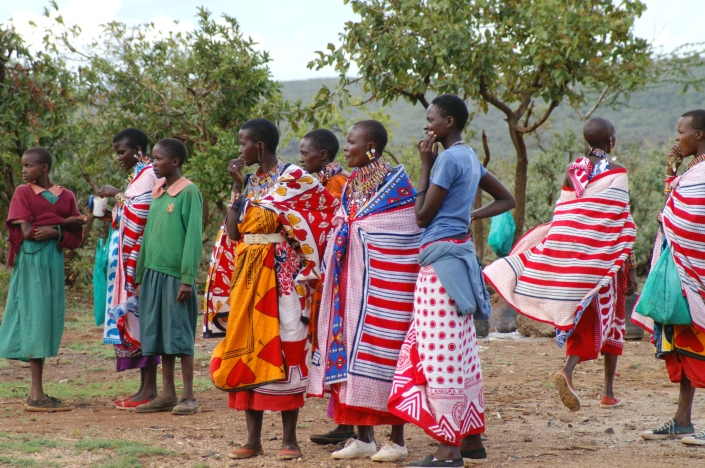 Maasai women and some students at a school event in Olmaroroi